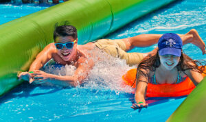 An inflatable water slide offers lots of fun for thrill seekers of all ages