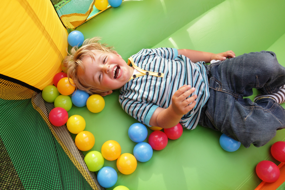 a child enjoying a birthday party or graduation party in a bounce house