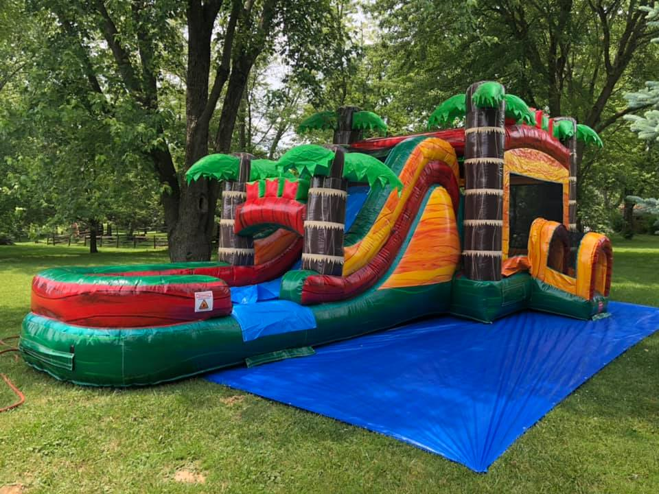 Large commercial inflatables like this inflatable water slide are pricier and more difficult to work with, but last forever if cared for properly. Note the use of a large commercial tarp set up underneath.